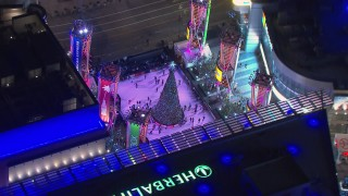 CAP_018_191 - HD stock footage aerial video of orbiting an ice skating rink at night, Downtown Los Angeles, California