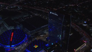 CAP_018_196 - HD stock footage aerial video of flying away from Ritz-Carlton Hotel at night, Downtown Los Angeles, California