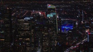 CAP_018_206 - HD stock footage aerial video zoom to wider view of towering skyscrapers at night, Downtown Los Angeles, California