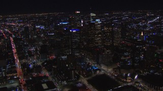 CAP_018_208 - HD stock footage aerial video of a wide orbit of tall skyscrapers at night, Downtown Los Angeles, California