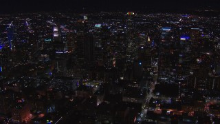 CAP_018_210 - HD stock footage aerial video of passing tall skyscrapers at night, zoom closer to US Bank Tower, Downtown Los Angeles, California