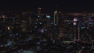 CAP_018_219 - HD stock footage aerial video zooming to wider view of skyline at night, Downtown Los Angeles, California