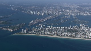 CAP_020_010 - HD stock footage aerial video of approaching South Beach near the port and Downtown Miami, Florida