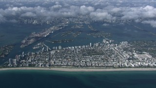 CAP_020_011 - HD stock footage aerial video of slowly passing South Beach, seen from high altitude, Miami, Florida