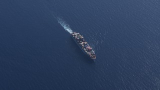 CAP_020_015 - HD stock footage aerial video of a bird's eye view of a cargo ship near Miami Beach, Florida