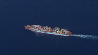 CAP_020_018 - HD stock footage aerial video of tracking a cargo ship near Miami Beach, Florida