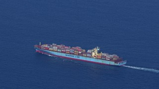 CAP_020_021 - HD stock footage aerial video of tracking a cargo ship as it sails the ocean near Miami Beach, Florida
