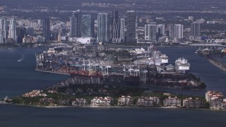 CAP_020_026 - HD stock footage aerial video of passing Fisher Island, Port of Miami and downtown skyline, Florida