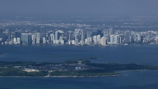 CAP_020_029 - HD stock footage aerial video zoom to a closer view of the Downtown Miami skyline across Biscayne Bay, Florida
