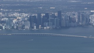 CAP_020_042 - HD stock footage aerial video of the city's skyline behind the Rickenbacker Causeway, Miami, Florida