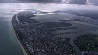 CAP_020_059 - HD stock footage aerial video of flying over Miami Beach toward Biscayne Bay and Downtown Miami, Florida