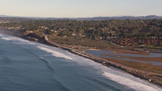CAP_021_004 - HD stock footage aerial video of Torrey Pines Road and hillside homes in Del Mar, California