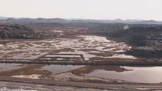 CAP_021_010 - HD stock footage aerial video flying by marshlands and coastal highway, Encinitas, California