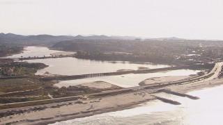 CAP_021_013 - HD stock footage aerial video of a lagoon and coastal highway by a beach, Encinitas, California
