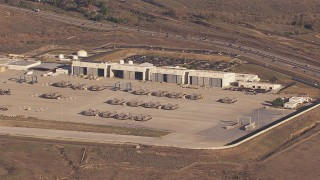 CAP_021_028 - HD stock footage aerial video of military craft and hangars at Camp Pendleton South, California