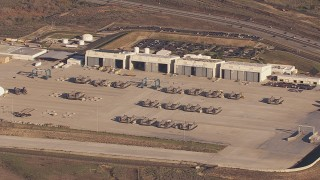 CAP_021_029 - HD stock footage aerial video of slowly passing military craft and hangars at Camp Pendleton South, California