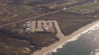 CAP_021_035 - HD stock footage aerial video of a reverse view of military craft at Camp Pendleton South, California