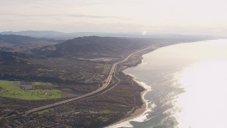 CAP_021_054 - HD stock footage aerial video of flying away from I-5 by coastal neighborhoods in San Clemente, California