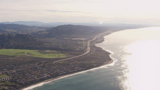 CAP_021_055 - HD stock footage aerial video of a reverse view of I-5 by coastal neighborhoods in San Clemente, California