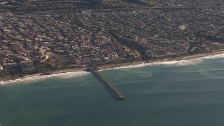 CAP_021_057 - HD stock footage aerial video of flying away from a pier by coastal neighborhoods in San Clemente, California