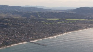 CAP_021_058 - HD stock footage aerial video of a wide view of a pier by coastal neighborhoods in San Clemente, California