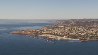 CAP_021_059 - HD stock footage aerial video of approaching the harbor and coastal neighborhoods in Dana Point, California