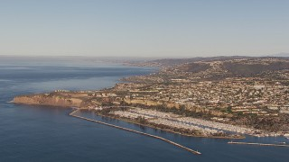 CAP_021_060 - HD stock footage aerial video of flying toward the harbor and coastal neighborhoods in Dana Point, California