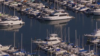 CAP_021_062 - HD stock footage aerial video of orbiting yachts and sailboats at the harbor in Dana Point, California