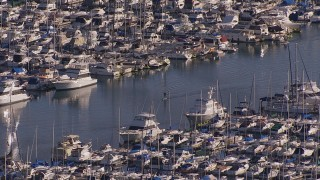 CAP_021_063 - HD stock footage aerial video of flying away from yachts and sailboats at the harbor in Dana Point, California