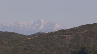 CAP_021_066 - HD stock footage aerial video of a wide view of distant snowy mountains in Dana Point, California