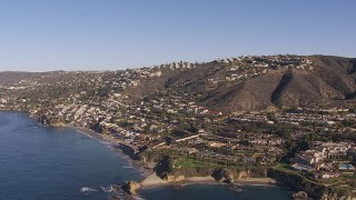 CAP_021_068 - HD stock footage aerial video flying by hillside homes and coastal neighborhoods in Laguna Beach, California