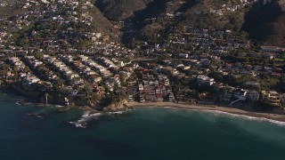 CAP_021_069 - HD stock footage aerial video flying by beach and oceanfront mansions in Laguna Beach, California