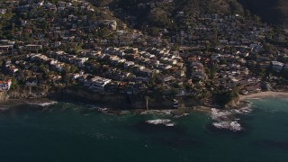 CAP_021_070 - HD stock footage aerial video flying by and away from oceanfront mansions in Laguna Beach, California