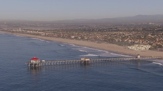 CAP_021_081 - HD stock footage aerial video of flying toward a diner on a pier, Huntington Beach, California