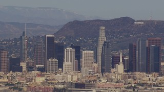 CAP_021_086 - HD stock footage aerial video of the city's skyline and Hollywood Sign, Downtown Los Angeles, California