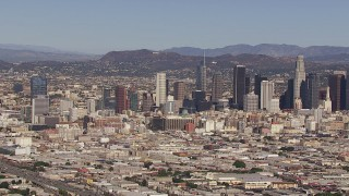 CAP_021_090 - HD stock footage aerial video of flying toward the city's skyline and Hollywood Sign, Downtown Los Angeles, California