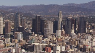 CAP_021_093 - HD stock footage aerial video of passing by skyscrapers in the city's skyline, Downtown Los Angeles, California