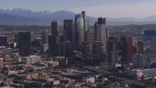 CAP_021_099 - HD stock footage aerial video of flying by towering skyscrapers in the city's skyline, Downtown Los Angeles, California