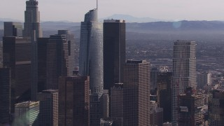CAP_021_101 - HD stock footage aerial video zoom in on Wilshire Grand Center skyscraper, Downtown Los Angeles, California