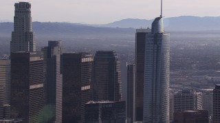 CAP_021_102 - HD stock footage aerial video flyby Wilshire Grand Center and US Bank Tower skyscrapers, Downtown Los Angeles, California