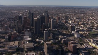 CAP_021_108 - HD stock footage aerial video flyby and approach towering skyscrapers in the city's skyline, Downtown Los Angeles, California