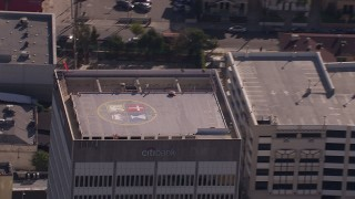 CAP_021_114 - HD stock footage aerial video of flying away from the roof of an office building in Echo Park, Los Angeles, California
