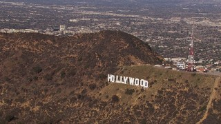 CAP_021_118 - HD stock footage aerial video of orbiting the famous Hollywood Sign, Los Angeles, California