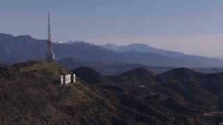 CAP_021_121 - HD stock footage aerial video of the famous Hollywood Sign and distant mountains, Los Angeles, California