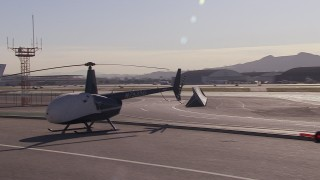 CAP_021_137 - HD stock footage aerial video of passing civilian jets and helicopters by a Burbank Airport hangar, California