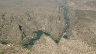 CAP_026_003 - HD stock footage aerial video of orbiting a deep canyon and river near Victoria Falls, Zimbabwe
