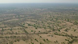 CAP_026_009 - HD stock footage aerial video of flying over open savanna, Zimbabwe