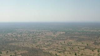 CAP_026_010 - HD stock footage aerial video of a wide view across open savanna, Zimbabwe