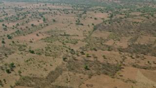 CAP_026_011 - HD stock footage aerial video of flying above open savanna, Zimbabwe