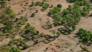 CAP_026_015 - HD stock footage aerial video orbiting a village in open savanna, Zimbabwe